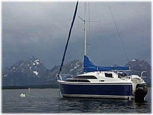 A MacGregor boat at anchor