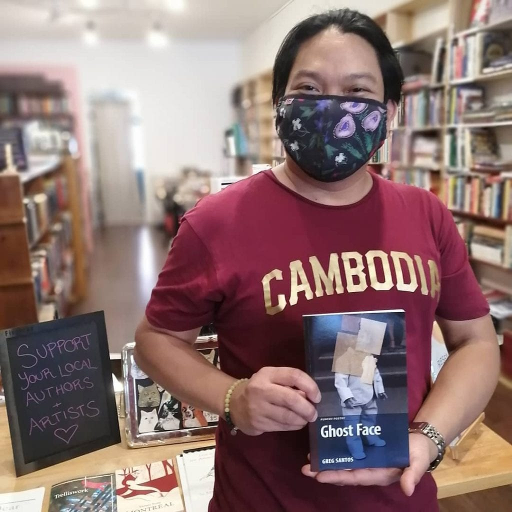Greg Santos holding a copy of his new book, Ghost Face.